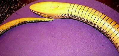 "Dominican all wood 32"" coiled snake very flexible looks feels real excellent con 4"