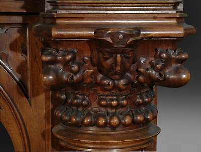 A Monumental Gothic Style Carved Walnut & Polychrome Decorated Fireplace 10