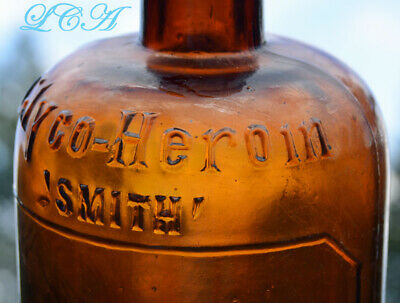 Antique HEROIN embossed QUACK MEDICINE bottle.  Large, early hand blown, RARE 3