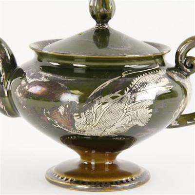Japanese moss agate glazed stoneware tea set with silver deposit drago... Lot 83