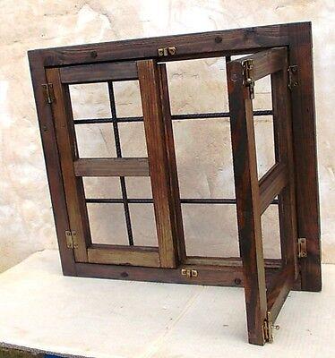 ventana de madera 2 hojas con rejas forjadas 2