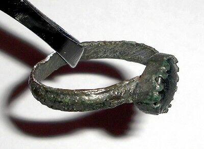 Medieval bronze ring with green glass stone