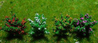 50 dunkelgrüne Büsche, rot, gelb, weiß, und violett blühend, 28 mm hoch 11