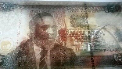 Kenya P41a, 50 Shillings Kenyata / Mobasa Tusks Mnmt, camel caravan $5CV UNC