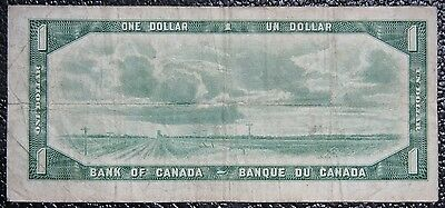 BANK OF CANADA 1954 - $1 DEVIL'S FACE NOTE - Prefix E/A - Signed Coyne & Towers