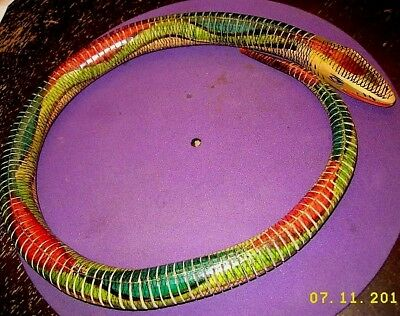 "Dominican all wood 32"" coiled snake very flexible looks feels real excellent con 2"