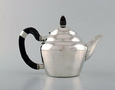 Early and rare Georg Jensen teapot in hammered silver with handle in ebony 2
