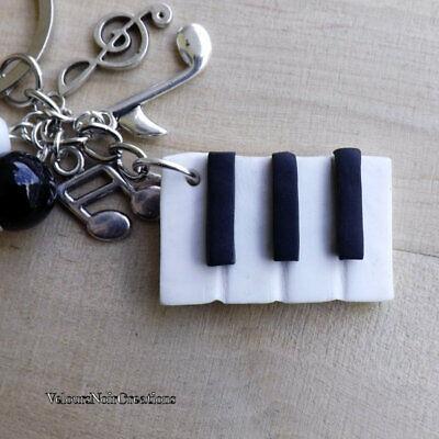 John Lennon Imagine pianoforte metallo argento ufficiale regalo portachiavi Abbigliamento e accessori