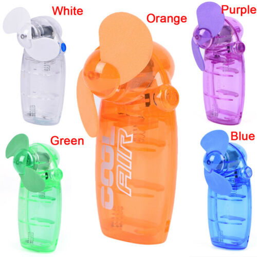 Mini Portable Pocket Fan Cool Air Hand Held Battery Button Type Blower Cooler HG