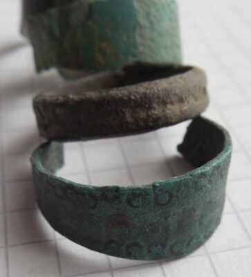 Viking period 4 bronze rings with signs 2