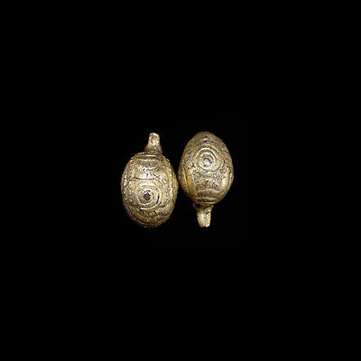 A pair of Khmer gold-coated silver earrings in the form of water fowl. 09989