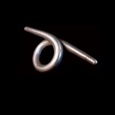 A Vietnamese silver ear ornament. 09962