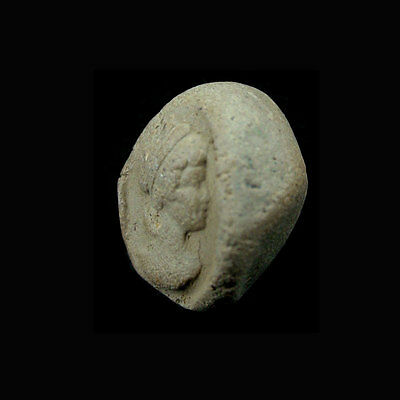 A Phoenician clay bulla the image depicting a ladies head in profile. e8103 2