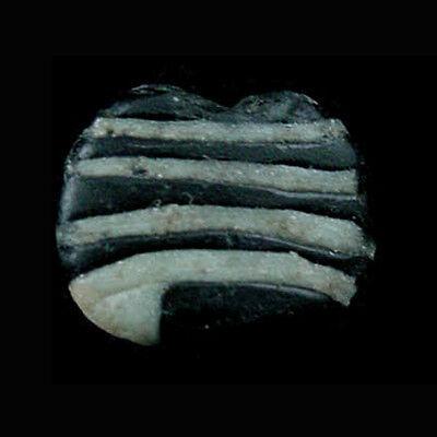 A Hasanlu glass bead. 3