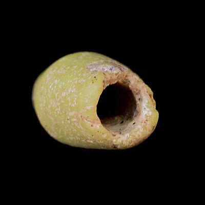 Islamic cylindrical yellow glass bead. x8272 2