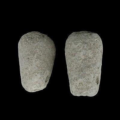 Two early Greek terracotta loom weights. E8260 3