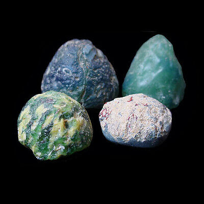 Set of four (4) Islamic coloured glass game pieces. E3955 2
