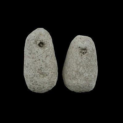 Two early Greek terracotta loom weights. E8260 2