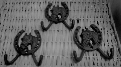 1 Cast Iron Horse Head inside of a horshoe  2 hook Coat rack or towel holder