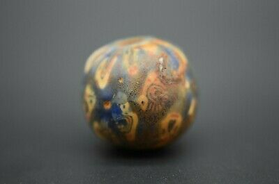 Medieval Islamic glass face bead C. 13th century AD 4