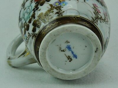 Antique Japanese pitcher with bird and flowers. Signed.  (BI#MK/0317.TMP)