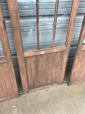 AN three-piece antique oak beveled glass center cabinet doors