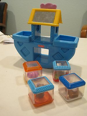 fisher price peek a block boat with the 4 blocks that fit into the boat