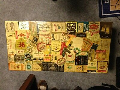 Antique Coffee table with Vintage alcohol labels