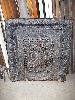 cast iron fire front decorative figure featured in center (F 1)