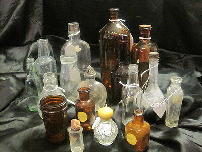 LOT OF 17 ANTIQUE VINTAGE OLD GLASS BOTTLES, CLEAR AND BROWN, SOME WITH CORKS
