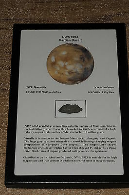 NWA 6963 Martian 2.87 gram slice. Beautiful frame ready to display the meteorite