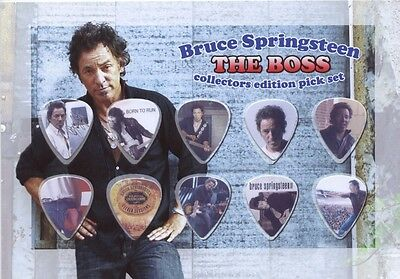 Bruce Springsteen guitar picks on photo display