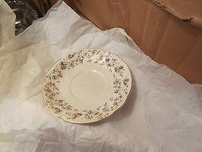 Ridgways saucer 5 3/4 inches across brown flowers on white background