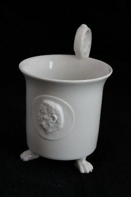 KPM Berlin cup footed lion paws biscuit medallion scepter mark, white porcelain