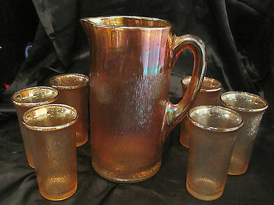 Carnival Glass Pitcher and 6 Tumblers, Jeannette Marigold Tree Bark Pattern