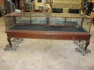 ANTIQUE WOODEN AND GLASS DISPLAY COUNTER