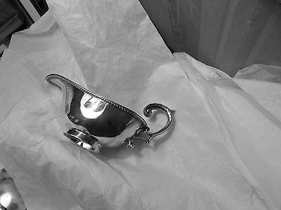 Small silver-plated sauce boat 5 1/4 inches long marked W A England no tray