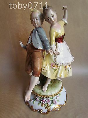 CAPODIMONTE NAPLES FIGURINE OF TWO YOUNG PEOPLE DANCING