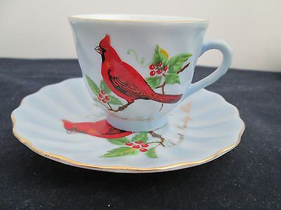 VINTAGE BLUE WITH A RED BIRD CUP AND SAUCER  MARKED GREAT SMOKEY MTS.