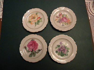 """PORCELAIN TEA CADDY'S/31/2""""DIFFERANT FLOWER ON EACH ONE.MADE IN JAPAN"""