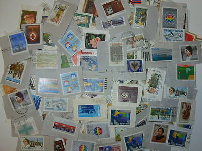 1/4 pound + No small around 500 large Canada stamps on