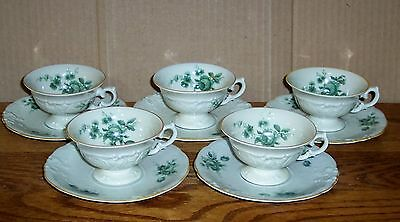 5  KPM CUPS AND SAUCERS WHITE WITH GREEN FLOWERS ( ROSES ? ) AND GOLD TRIM