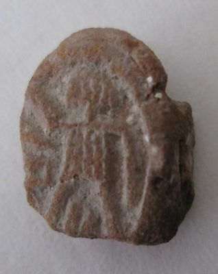 Clay Bulla - Shows A Figure Facing To The Right, Raising Right Hand - Archeology