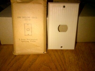 Ivory (Bakelite?) Antique switch plate/receptacle, single gang,