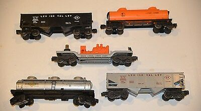 LIONEL LOT OF CARS INCLUDING SONOCO TANK 2 HOPPERS SEARCHLIGHT CAR & LIONEL TANK