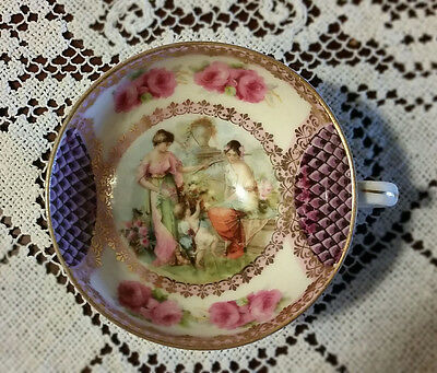 Antique demi-tasse or tea cup and saucer, intricate design