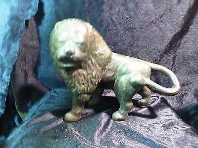 """9"""" long cast iron lion doorstop old and weighs 10 pounds"""