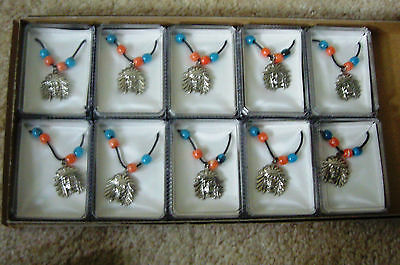 Lot of Ten Native American Indian Head Necklaces with Turquoise and Coral Stones