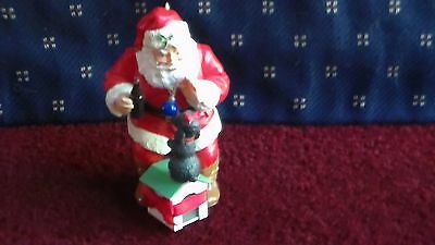 C.Cola Ceramic ornament: Santa Claus playing with dog on dog house.11 inch tall