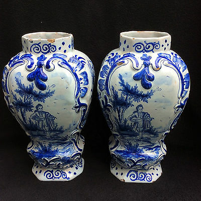 A FINE PAIR OF HAND PAINTED 18TH/19TH CENTURY DUTCH DELFT VASES. MARKED